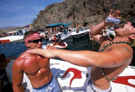 Two-men-drink-and-party-at-Lake-Havasu-on-Memorial-Day-weekend
