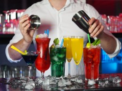 bartender pouring different types of drinks