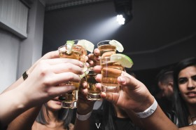 photo of cheers with tequila shots